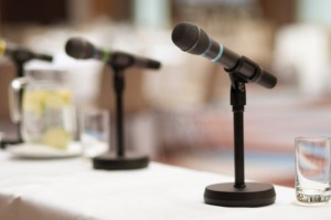an image of two microphones at conference table